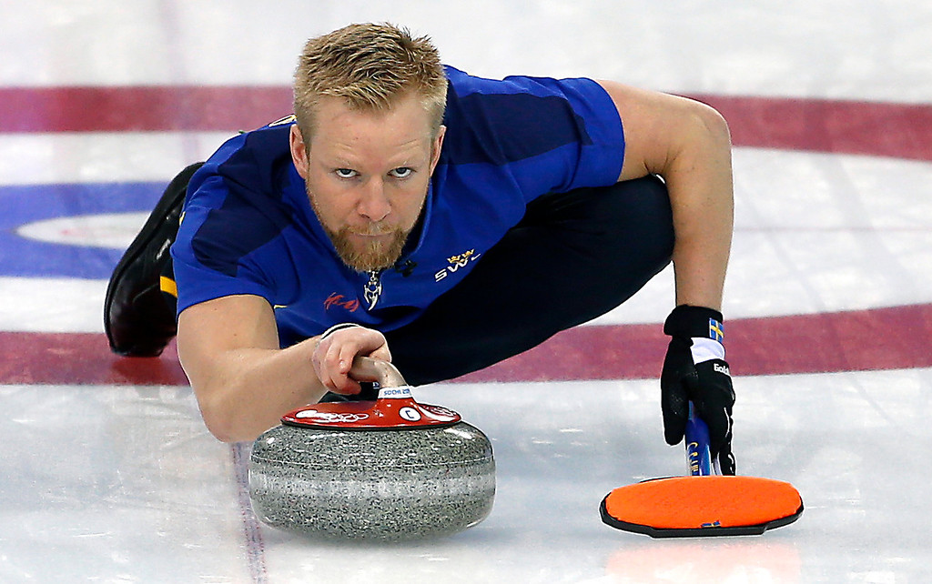 . Sweden\'s skip Niklas Edin sweeps the ice during the men\'s curling match against Russia at the 2014 Winter Olympics, Sunday, Feb. 16, 2014, in Sochi, Russia. (AP Photo/Wong Maye-E)