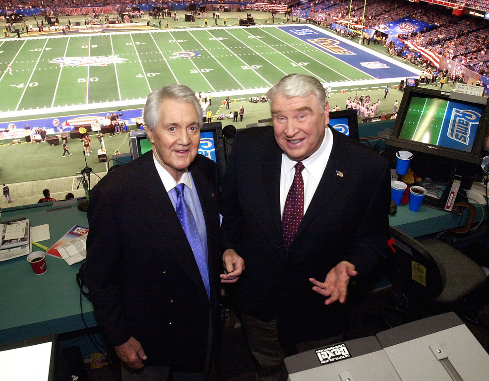 . FILE - In this Feb. 3, 2002, file photo, Fox broadcasters Pat Summerall, left, and John Madden stand in the booth at Louisiana Superdome before the NFL Super Bowl XXXVI football game in New Orleans. Fox Sports spokesman Dan Bell said Tuesday, April 16, 2013, that Summerall, the NFL player-turned-broadcaster whose deep, resonant voice called games for more than 40 years, has died at the age of 82. (AP Photo/Ric Feld, File)