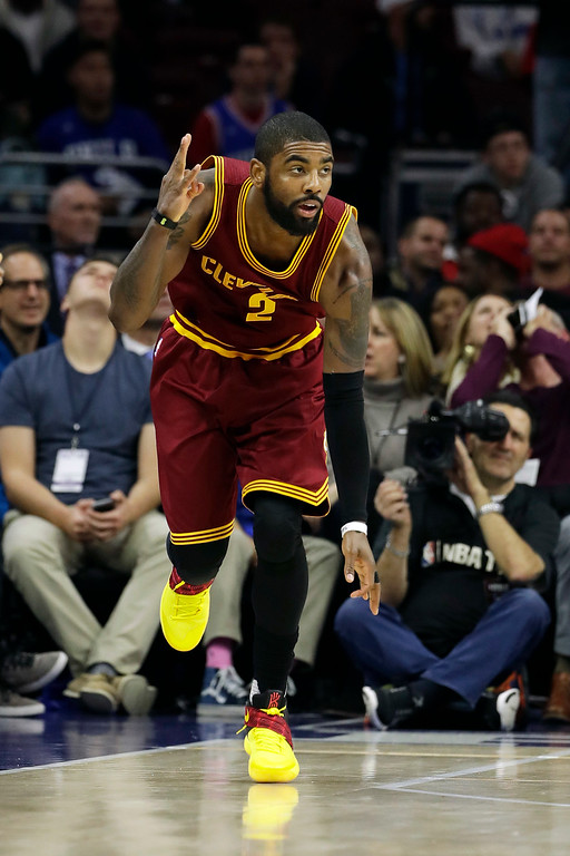 . Cleveland Cavaliers\' Kyrie Irving celebrates after scoring a three-point basket during the second half of an NBA basketball game against the Philadelphia 76ers, Sunday, Nov. 27, 2016, in Philadelphia. (AP Photo/Matt Slocum)