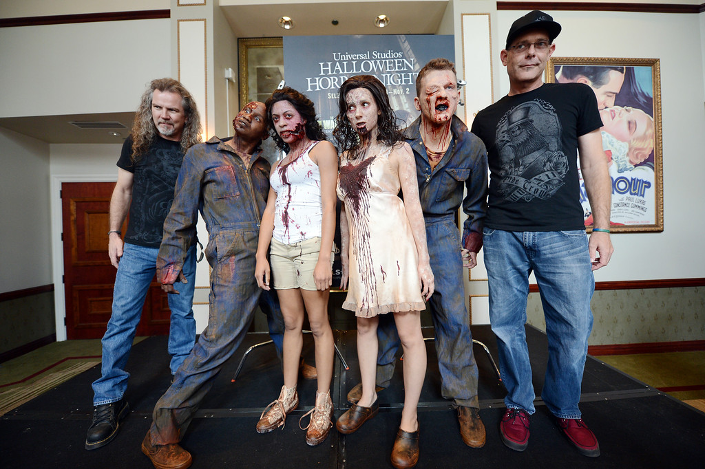 . Extreme horror makeup artist Larry Bones, left, and \'Halloween Horror Nights\' Creative Director John Murdy, right, pose with monsters for the cameras during a press preview of Universal Studios \'Halloween Horror Nights� at Universal Studios Tuesday, August 27, 2013. \'Halloween Horror Nights� begins on Friday, September 20, and continues on 21 select nights through November 2, 2013. (Hans Gutknecht/Los Angeles Daily News)