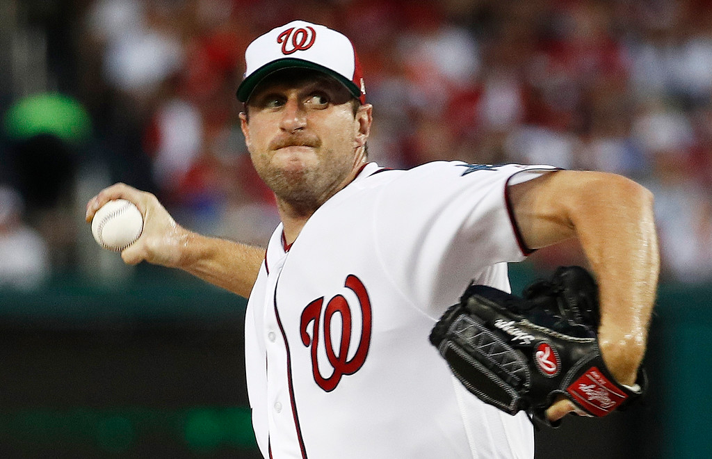 . Washington Nationals pitcher Max Scherzer (31) throws during first inning of the Major League Baseball All-star Game, Tuesday, July 17, 2018 in Washington. (AP Photo/Patrick Semansky)