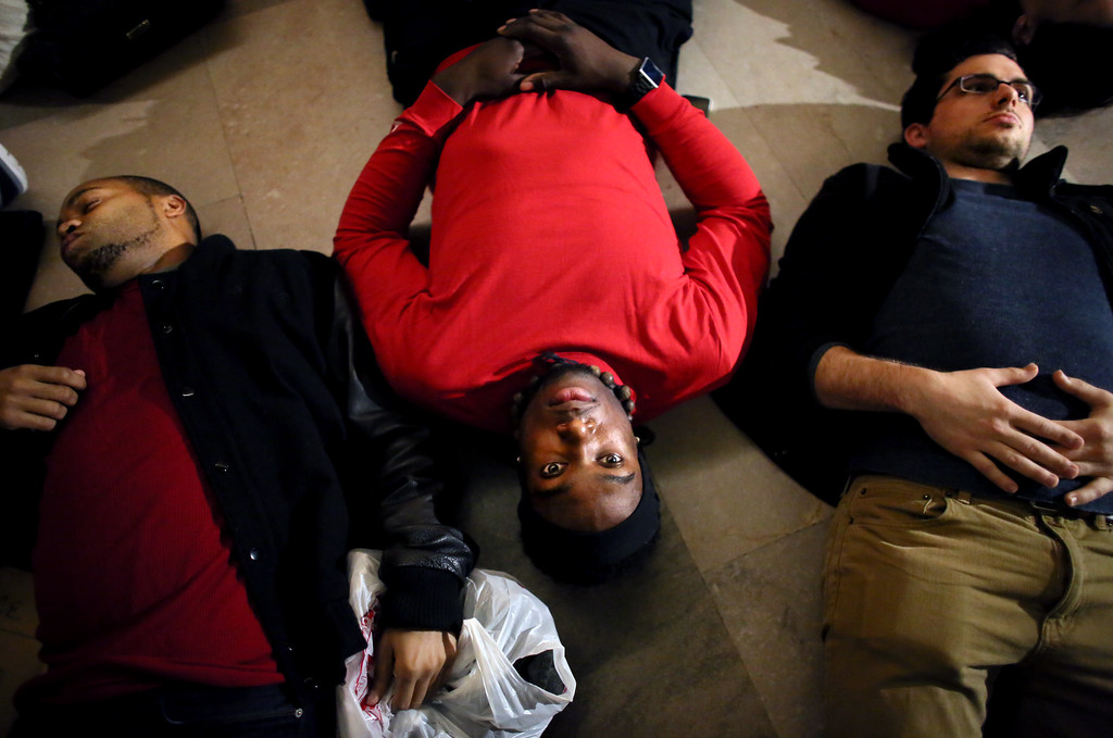 . NEW YORK - DECEMBER 3: Demonstrators lie down during a protest in Grand Central Terminal December 3, 2014 in New York. Protests began after a Grand Jury decided to not indict officer Daniel Pantaleo. Eric Garner died after being put in a chokehold by Pantaleo on July 17, 2014. Pantaleo had suspected Garner of selling untaxed cigarettes. (Photo by Yana Paskova/Getty Images)