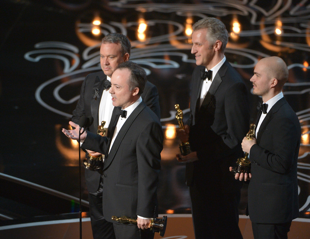 . Neil Corbould,  from left, Tim Webber, David Shirk, and Chris Lawrence accept the award for best visual effects for ìGravityîduring the Oscars at the Dolby Theatre on Sunday, March 2, 2014, in Los Angeles.  (Photo by John Shearer/Invision/AP)