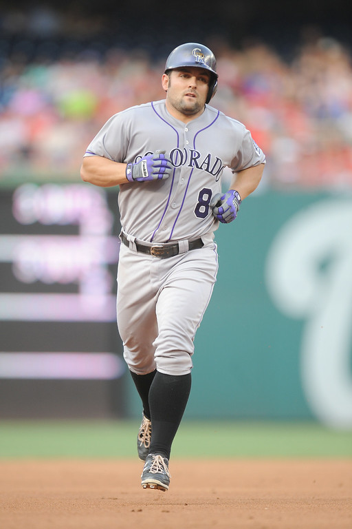 . Michael McKenry #8 of the Colorado Rockies runs the bases after hitting a three run home run in the second inning during a baseball against the Washington Nationals on July 2, 2014 at Nationals Park in Washington, DC.  The Nationals won 4-3.  (Photo by Mitchell Layton/Getty Images)