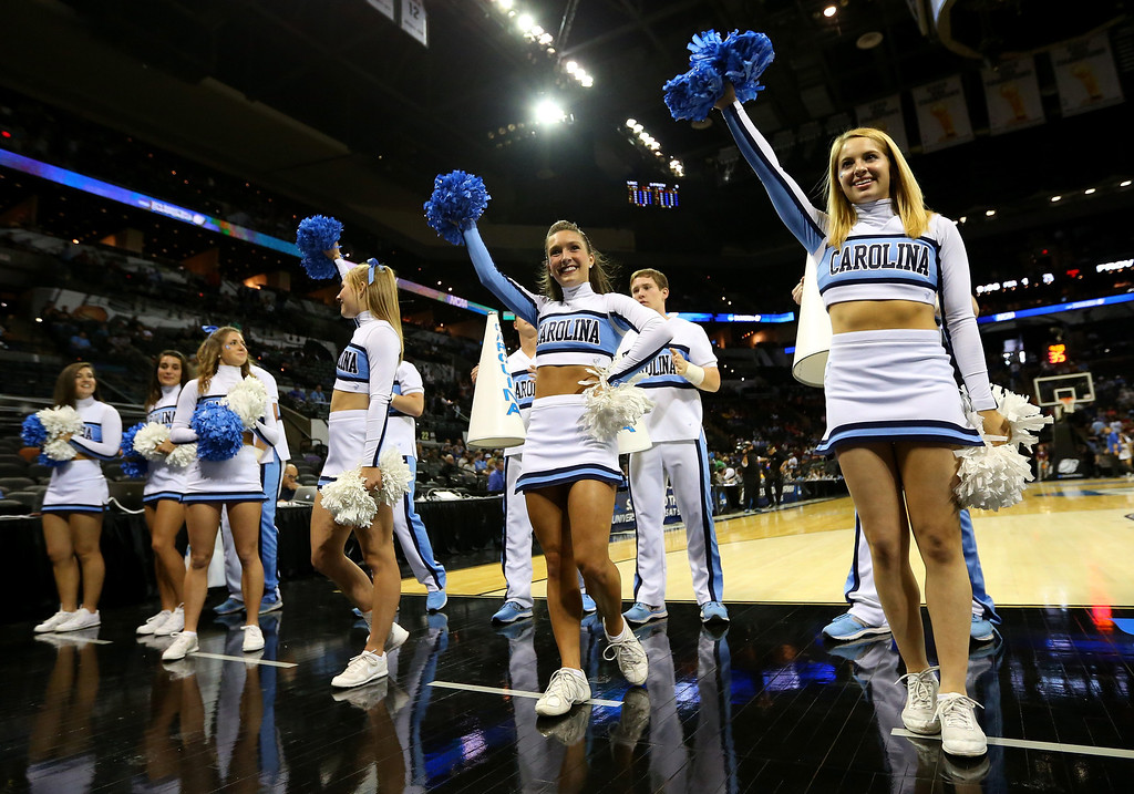. Cheerleaders from the North Carolina Tar Heels perform before the start the Tar Heels game against the Providence Friars in the second round of the 2014 NCAA Men\'s Basketball Tournament at AT&T Center on March 21, 2014 in San Antonio, Texas.  (Photo by Ronald Martinez/Getty Images)