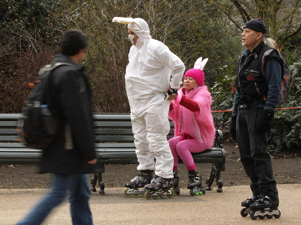 Description of . Skaters prepare their flamboyant rabbit costumes at Hyde Park, during the traditional Easter Bunny Stroll event in central London, Sunday March 31, 2013.  The Easter skate extravaganza attracts some hundreds of skate enthusiasts for a fun event to herald in the summer skating season. (AP Photo/Yui Mok, PA)