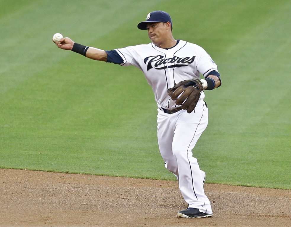 . San Diego Padres shortstop Everth Cabrera makes a  throw from the deep behind second base to get Colorado Rockies\' Tyler Colvin at first in the second inning of a baseball game in San Diego, Tuesday, July 9, 2013. (AP Photo/Lenny Ignelzi)