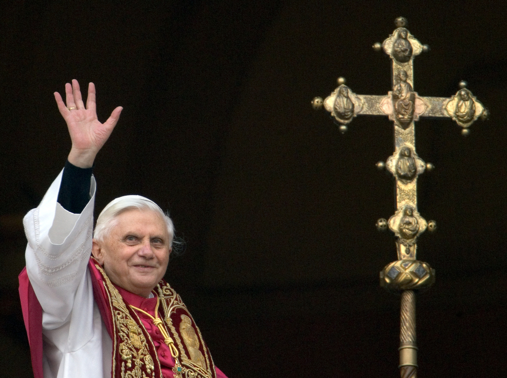 Description of . A file picture taken on April 19, 2005 shows Germany's Joseph Ratzinger, the new Pope Benedict XVI, waving to the crowd from the window of St Peter's Basilica's main balcony after being elected the 265th pope of the Roman at the Vatican City.Benedict XVI announced on February 11, 2013 he will resign on February 28 because his age prevented him from carrying out his duties, an unprecedented move in the modern history of the Catholic Church. PATRICK HERTZOG/AFP/Getty Images
