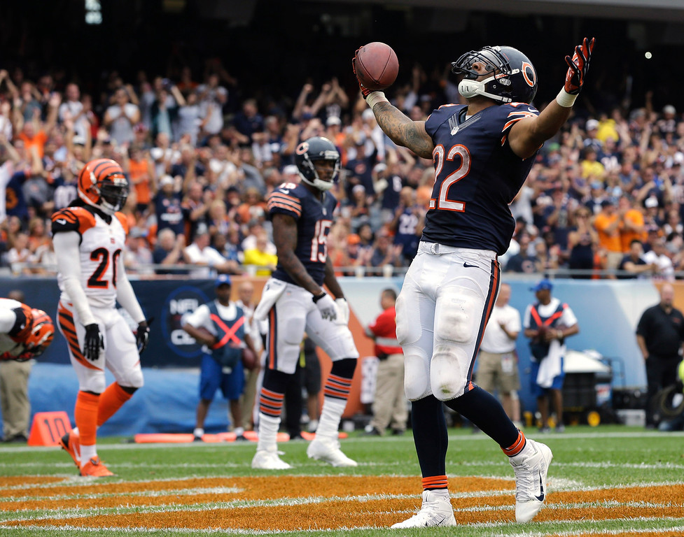 . Chicago Bears running back Matt Forte (22) celebrates after rushing for a touchdown against the Cincinnati Bengals during the second half of an NFL football game, Sunday, Sept. 8, 2013, in Chicago. (AP Photo/Nam Y. Huh)