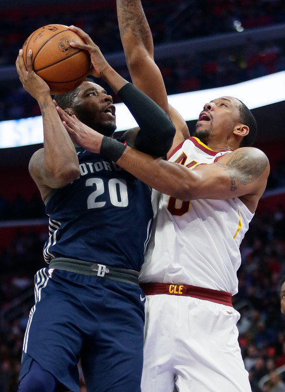 . Detroit Pistons guard Dwight Buycks (20) goes to the basket against Cleveland Cavaliers forward Channing Frye during the first half of an NBA basketball game Tuesday, Jan. 30, 2018, in Detroit. (AP Photo/Duane Burleson)