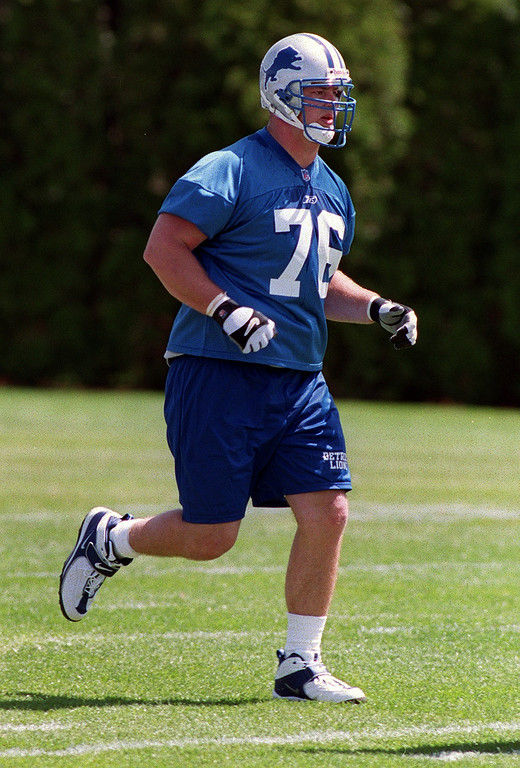 . Detroit Lions first round draft choice Jeff Backus (#76) runs during the Lions morning session of mini camp, Friday, April 27, 2001, at the Lions practice facility in Pontiac, Mich.  Backus was drafted from the University of Michigan.