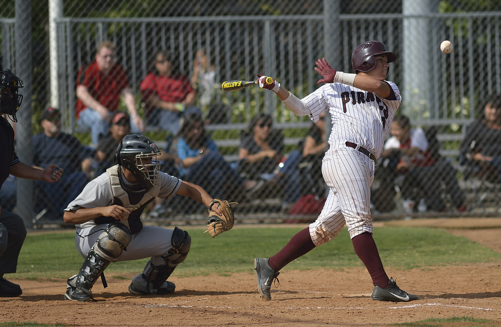 . PARAMOUNT, CALIF. USA -- Paramount\'s Joseph Moreno (8) takes a swing during their CIF-SS Division III playoff loss to Westminster in Paramount, Calif., on Thursday, May 16, 2013. Westminster defeated Paramount, 3 to 0.  Photo by Jeff Gritchen / Los Angeles Newspaper Group