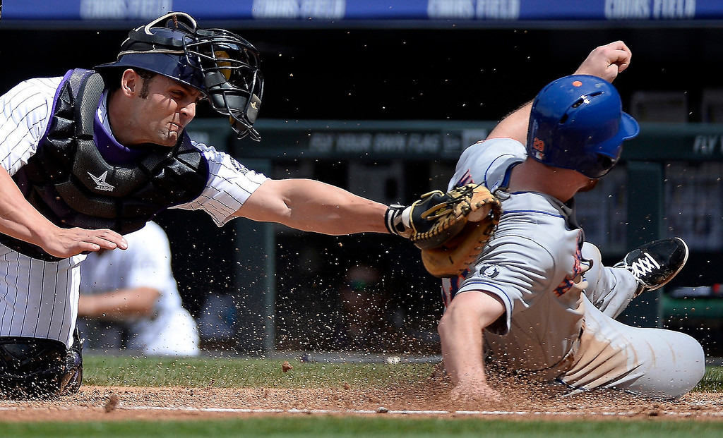 . Colorado Rockies catcher Michael McKenry (8) misses the tag on New York Mets second baseman Daniel Murphy (28) as he slides home on a double by New York Mets third baseman David Wright (5) double to center in the third inning May 4, 2014 at Coors Field. (Photo by John Leyba/The Denver Post)