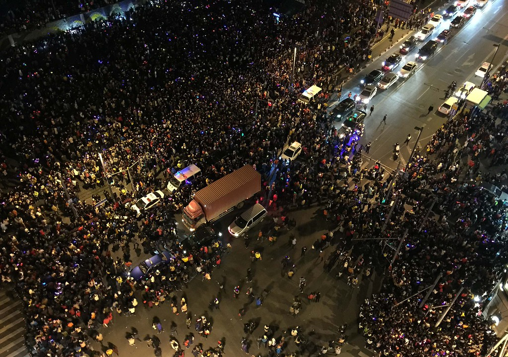 . This overhead view shows emergency vehicles (C) amongst the crowd after a stampede by new year\'s revellers in Shanghai\'s historic riverfront in Shanghai on January 1, 2015. The stampede by New Year\'s revellers in Shanghai\'s historic riverfront area killed 35 people and injured dozens more, the city government said on January 1.   CHINA OUT   AFP PHOTOSTR/AFP/Getty Images
