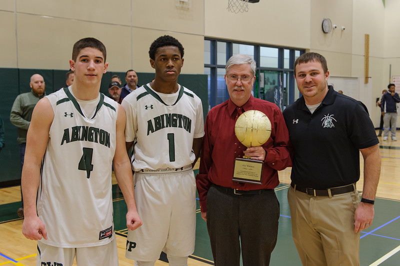 Abington's Don Whitman is recognized for his 50 years as the Abington High School boys basketball team statistician. (Right to Left) Peter Serino, AHS Athletic Director, Don Whitman, and co-captains Bryson Andrews - Will Klein  [Courtesy Photo/Bill Marquardt]