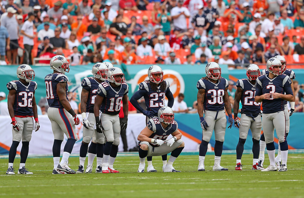 . The New England Patriots prepare to kick off during a game against the Miami Dolphins at Sun Life Stadium on December 15, 2013 in Miami Gardens, Florida.  (Photo by Mike Ehrmann/Getty Images)