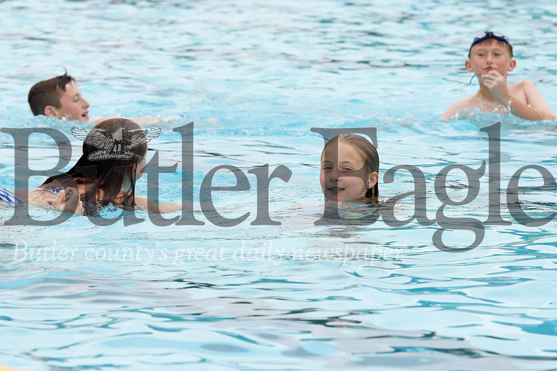 Avery Aglio (center), Harley Payne (left) and other Butler area kids didn't let cloudy skies dampen their spirits at the Alemeda Pool Monday. Seb Foltz/Butler Eagle