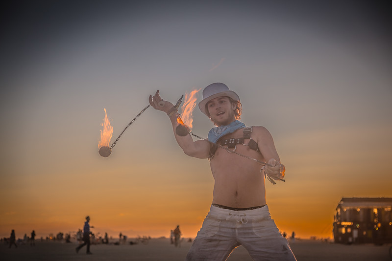 Fire Spinner At Sunrise