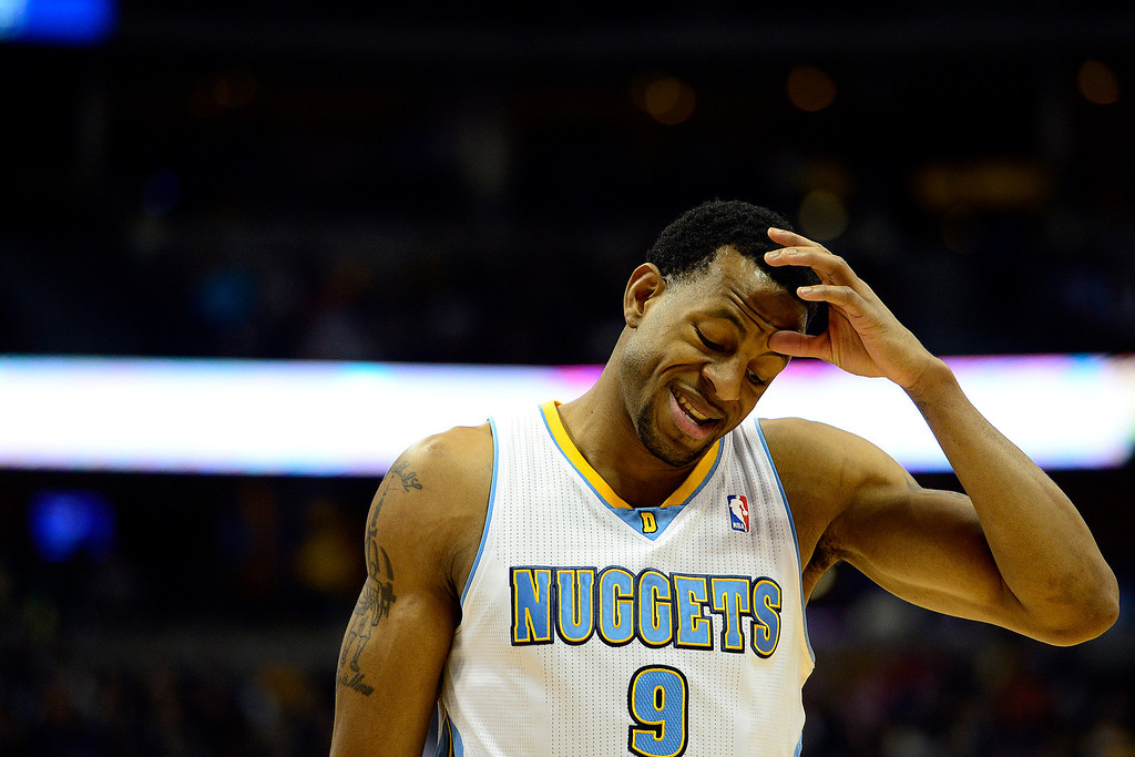 . Denver Nuggets shooting guard Andre Iguodala (9) rubs his head against the Los Angeles Lakers during the first half at the Pepsi Center on Wednesday, December 26, 2012. AAron Ontiveroz, The Denver Post