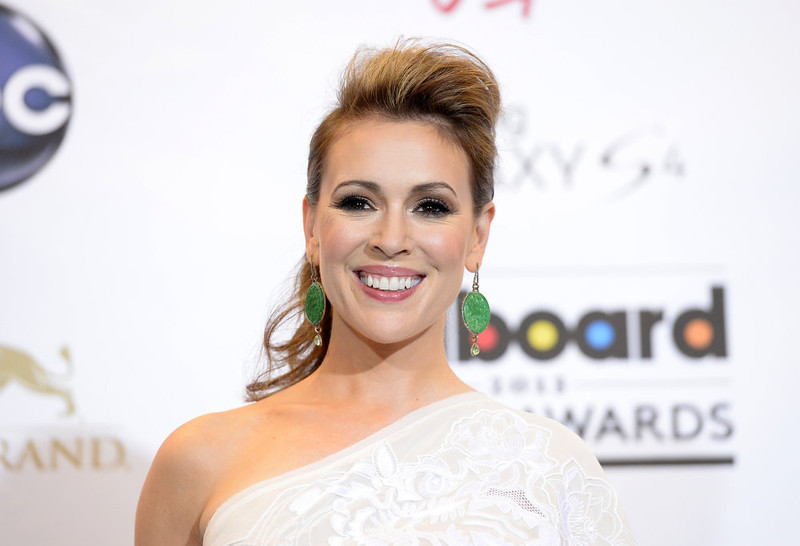 . Alyssa Milano poses in the press room during the 2013 Billboard Music Awards at the MGM Grand Garden Arena on May 19, 2013 in Las Vegas, Nevada.  (Photo by Jason Merritt/Getty Images)