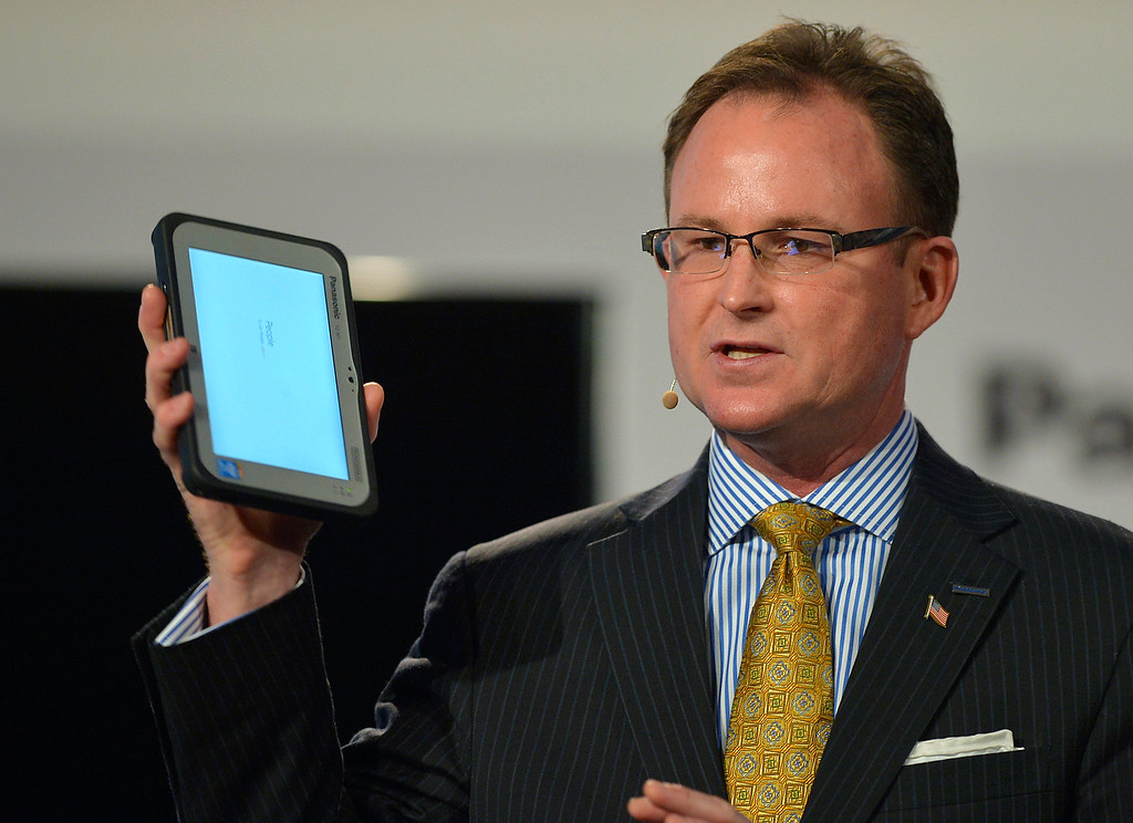 ". Rance Poehler, president of Panasonic Company of North America, shows off the new 7"" Toughpad FZ-M1 tablet during the Panasonic news conference at the 2014 International Consumer Electronics Show Monday, Jan. 6, 2014, in Las Vegas. (AP Photo/Jack Dempsey)"