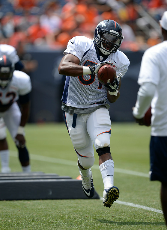 . Denver Broncos linebacker Jamar Chaney (51) catches a pass in drills on day four of the Denver Broncos 2014 training camp July 27, 2014 at Sports Authority Field at Mile High. (Photo by John Leyba/The Denver Post)