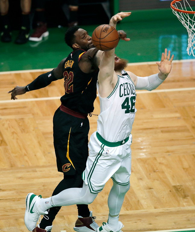 . Cleveland Cavaliers forward Jeff Green, rear, knocks the ball away from Boston Celtics center Aron Baynes during the second half in Game 7 of the NBA basketball Eastern Conference finals, Sunday, May 27, 2018, in Boston. (AP Photo/Charles Krupa)