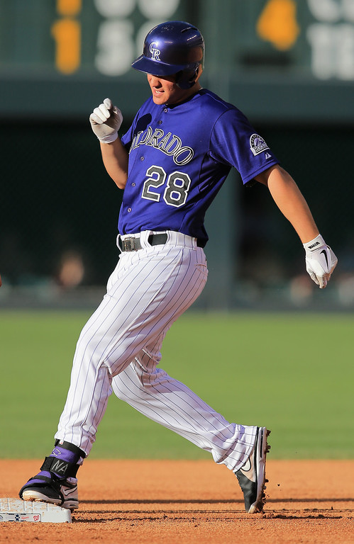 . Nolan Arenado #28 of the Colorado Rockies arrives at second base with a stand up double off of starting pitcher Dan Haren #15 of the Washington Nationals i nthe first inning at Coors Field on June 11, 2013 in Denver, Colorado.  (Photo by Doug Pensinger/Getty Images)