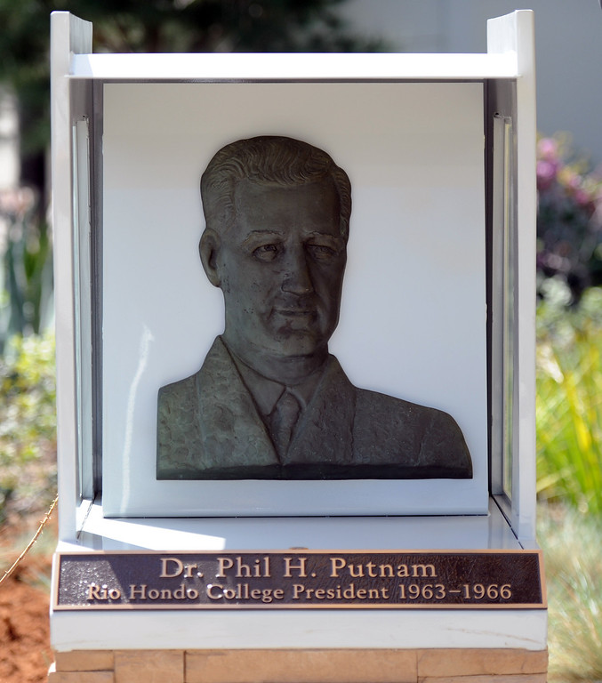 . The time capsule is buried underneath a staue of Dr. Phil Putnam, former Rio Hondo president during a celebration of the colleges 50th anniversary with a time capsule burial, cake and signing of a giant birthday card at Rio Hondo College on Thursday, March 14, 2013 in Whittier, Calif.  (Keith Birmingham Pasadena Star-News)