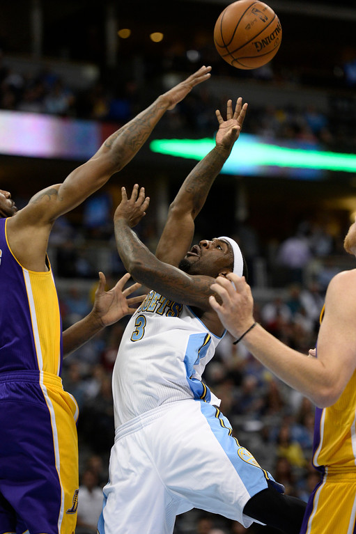 . DENVER, CO - NOVEMBER 13: Denver Nuggets point guard Ty Lawson (3) goes up for a shot on Los Angeles Lakers power forward Shawne Williams (3) during the first quarter November 13, 2013 at Pepsi Center. (Photo by John Leyba/The Denver Post)