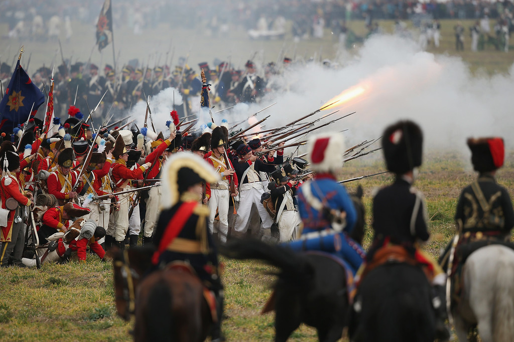 . Historical society enthusiasts in the role of Bavarian troops loyal to Napoleon advance during the re-enactment of The Battle of Nations on its 200th anniversary on October 20, 2013 near Leipzig, Germany.  (Photo by Sean Gallup/Getty Images)