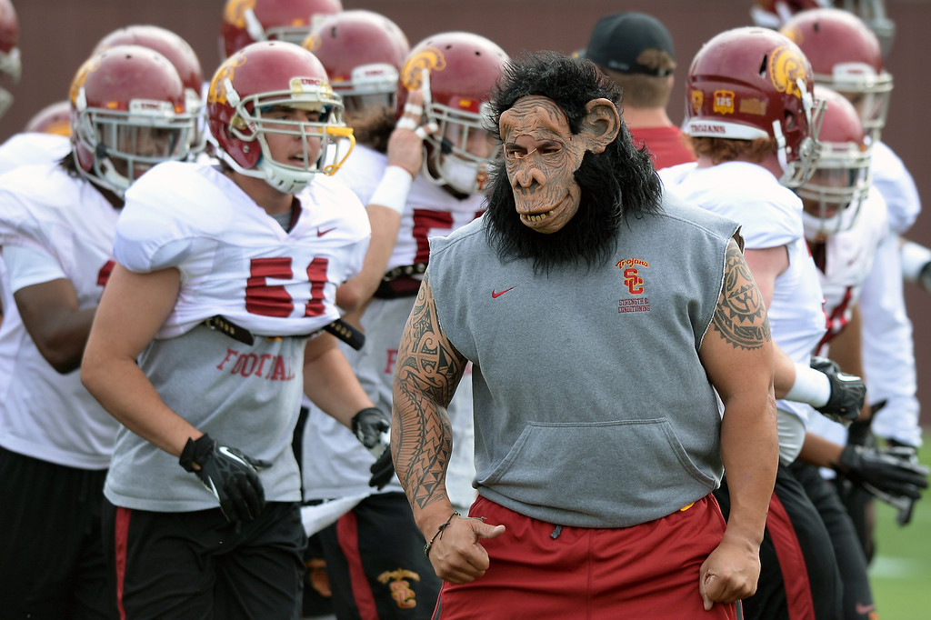 . Assistant strength coach Mark Philipp sports a mask to get the players pumped up during a drill, Tuesday, March 25, 2014, at USC. (Photo by Michael Owen Baker/L.A. Daily News)