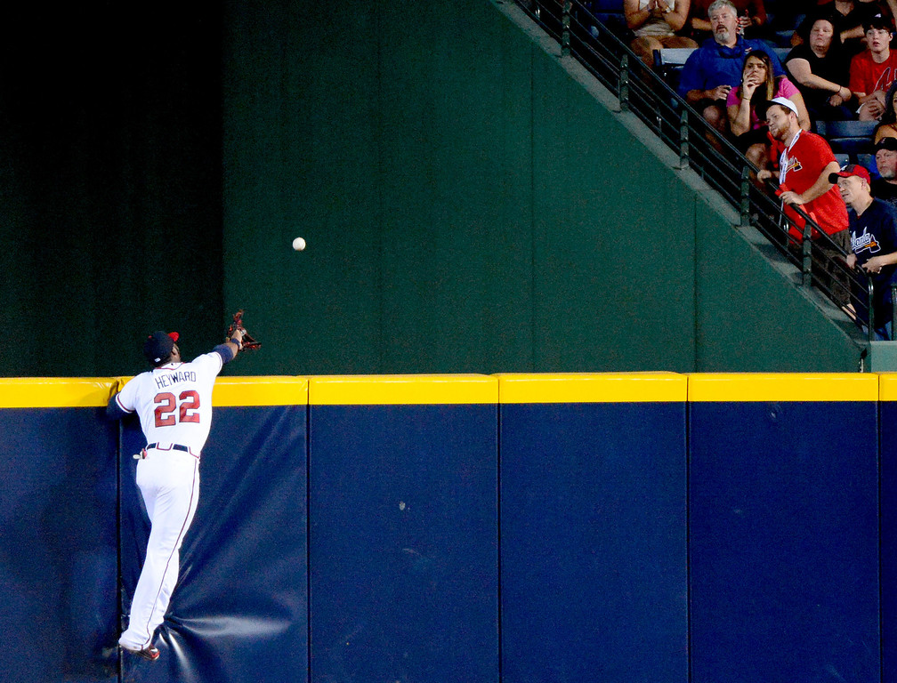 . Atlanta Braves\' Jason Heyward attempts to catch Los Angeles Dodgers\' Adrian Gonzalez\' home run in the first game of the playoffs Thursday, October 3, 2013 at Turner Field in Atlanta, Georgia. (Photo by Sarah Reingewirtz/Pasadena Star- News)