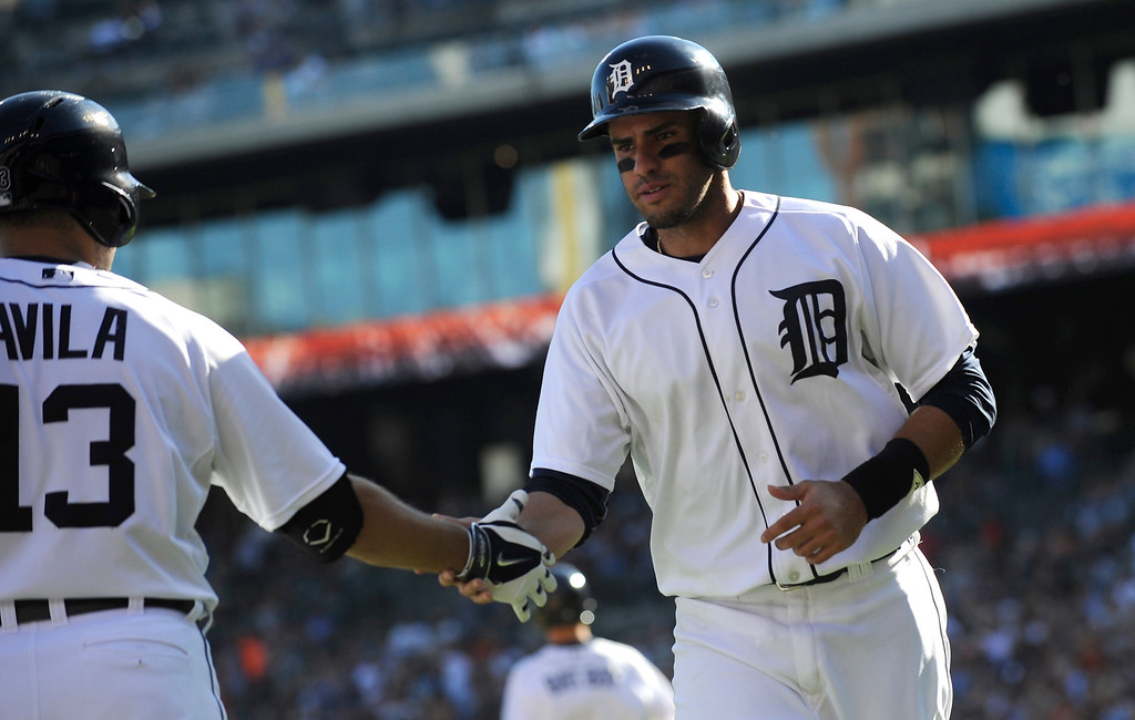 . Tigers\' J.D. Martinez, right, is congratulated by Alex Avila (13) after scoring in the third inning of a baseball game against the Kansas City Royals at Comerica Park in Detroit Monday Sept. 8, 2014.  (AP Photo/Detroit News, Elizabeth Conley)  DETROIT FREE PRESS OUT; HUFFINGTON POST OUT