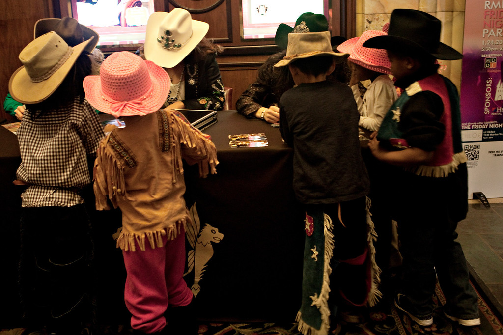 . DENVER, CO. - January 24: Miss Rodeo winners sign autographs for children from Denver\'s HOPE Center in the hotel lobby of the Brown Palace in Denver, Colorado on Friday, Jan. 24, 2014. Representatives from Miss Roadeo were on hand Friday morning while the winning steers of the National Western Junior Livestock Show were on display in the main lobby for crowds to pet and get their photos taken with.  (Photo By Katie Wood/The Denver Post)