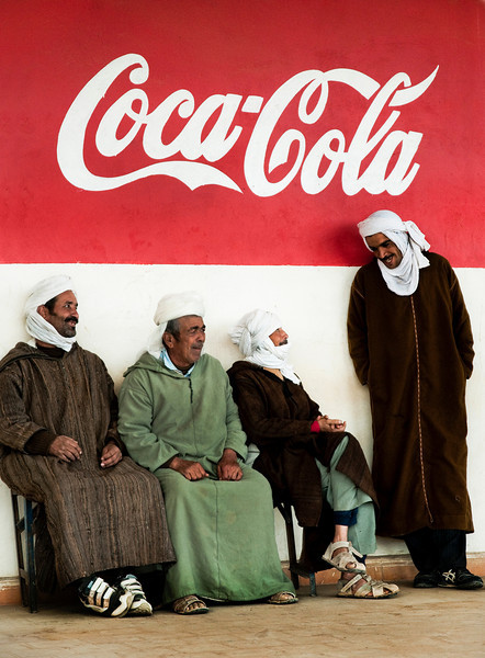 local men chatting outside a cafe in Hassi Labied.
