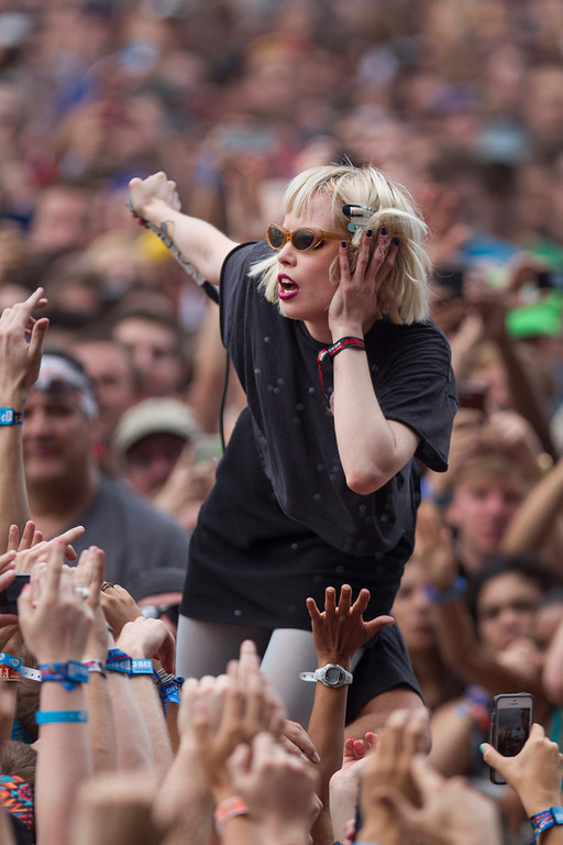 . Alice Glass, vocalist for Canadian electronic band Crystal Castles interacts with fans after jumping off stage during their performance at the Lollapalooza Festival in Chicago, Friday, Aug. 2, 2013. The more than two-decade-old festival opens Friday in Chicago\'s lakefront Grant Park. (AP Photo/Scott Eisen)