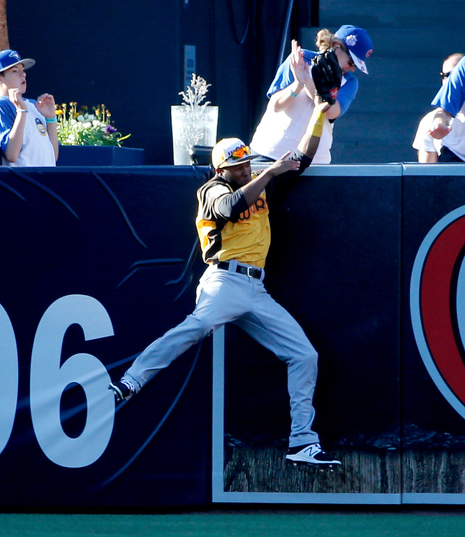 . World Team\'s Manuel Margot, of the San Diego Padres, takes a home run away from U.S. Team\'s Carson Kelly, of the St. Louis Cardinals, during the sixth inning of the All-Star Futures baseball game, Sunday, July 10, 2016, in San Diego. (AP Photo/Lenny Ignelzi)