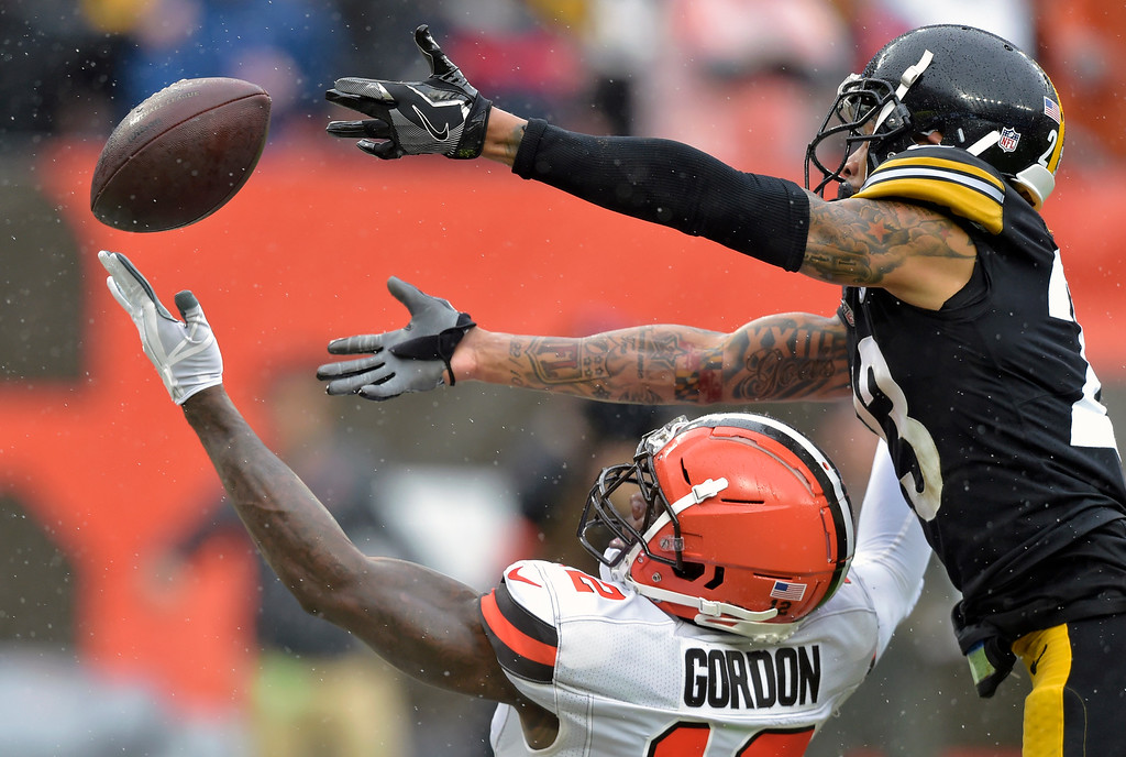 . Cleveland Browns wide receiver Josh Gordon, bottom, cannot hold onto the ball under pressure from Pittsburgh Steelers defensive back Joe Haden, top, during the second half of an NFL football game, Sunday, Sept. 9, 2018, in Cleveland. (AP Photo/David Richard)