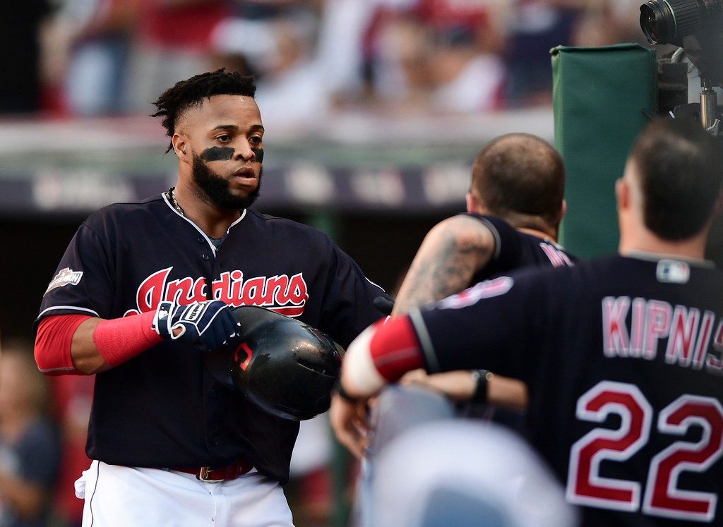 . Cleveland Indians\' Carlos Santana celebrates after scoring on a Brandon Guyer single against the Boston Red Sox during the second inning of Game 2 of a baseball American League Division Series, Friday, Oct. 7, 2016, in Cleveland. (AP Photo/David Dermer)