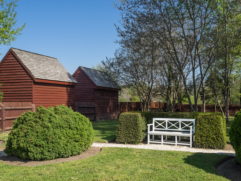 White Wooden Bench and Outbuildings in Colonial Williamsburg