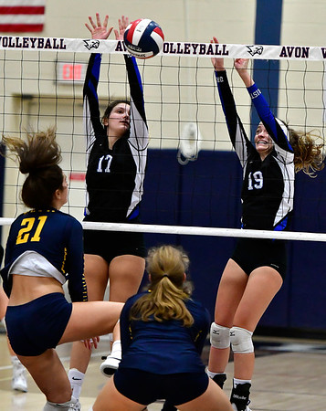 11/1/2018 Mike Orazzi | Staff RHAM High School's Bella Johnson (21) and Bristol Eastern's Gabriella Nozzolillo (17) and Amber Blais (19) during the CCC Volleyball Tournament at Avon High School Thursday night.