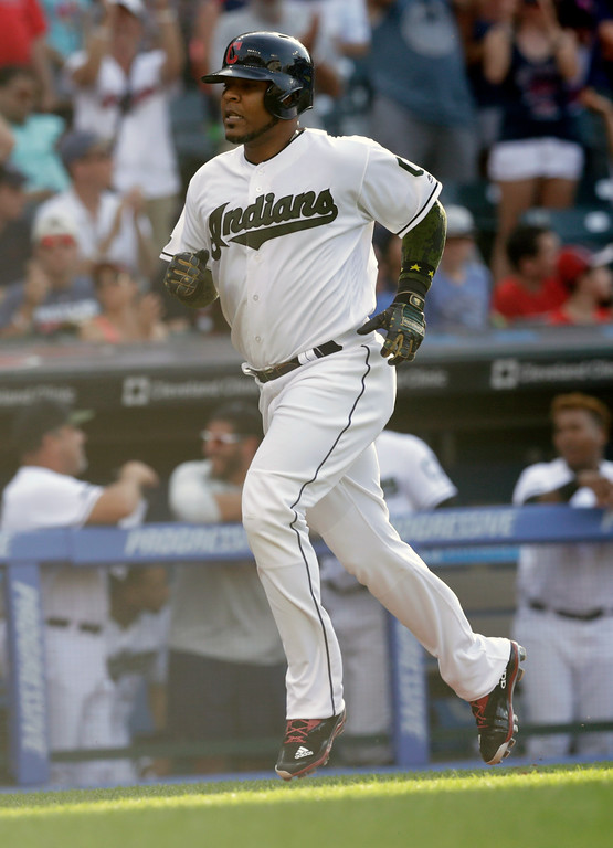 . Cleveland Indians\' Edwin Encarnacion runs the bases after hitting a solo home run in the seventh inning of a baseball game against the Chicago White Sox, Monday, May 28, 2018, in Cleveland. (AP Photo/Tony Dejak)