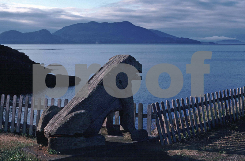 A large wooden icon sets at Doe Bay overlooking Puget Sound.