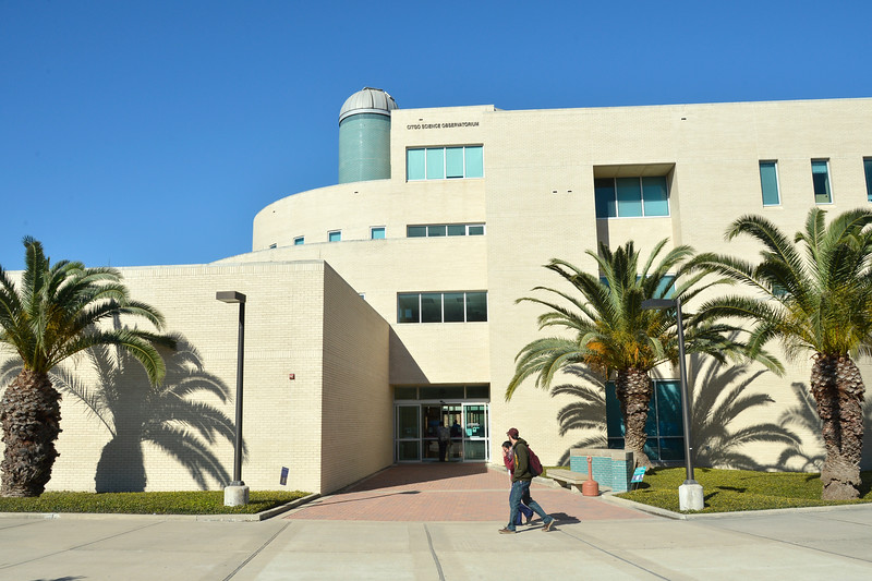 Students walk past the Engineering building on campus.