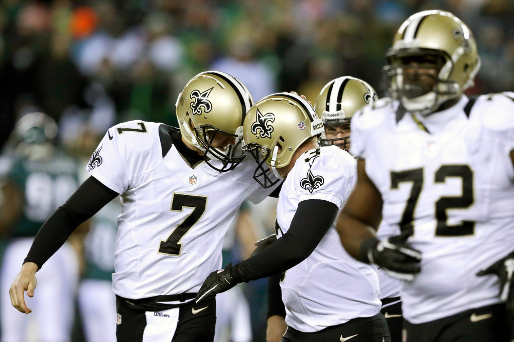 . New Orleans Saints\' Luke McCown (7) celebrates with Shayne Graham (3) after Graham\'s field goal during the first half of an NFL wild-card playoff football game against Philadelphia Eagles, Saturday, Jan. 4, 2014, in Philadelphia. (AP Photo/Julio Cortez)