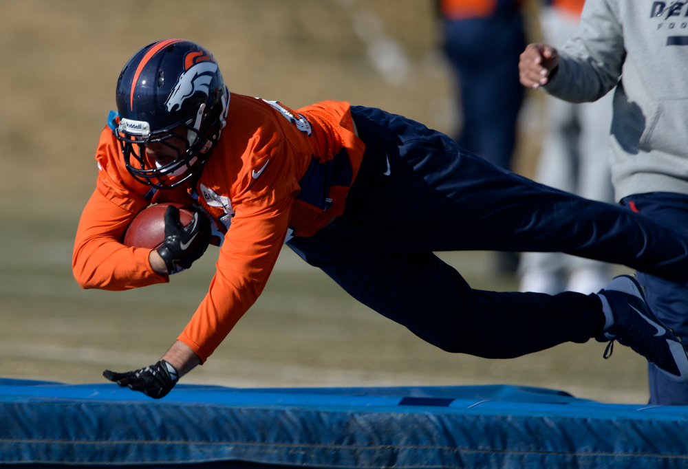 . Denver Broncos tight end Jacob Tamme (84) runs through drills during practice January 9, 2014 at Dove Valley (Photo by John Leyba/The Denver Post)