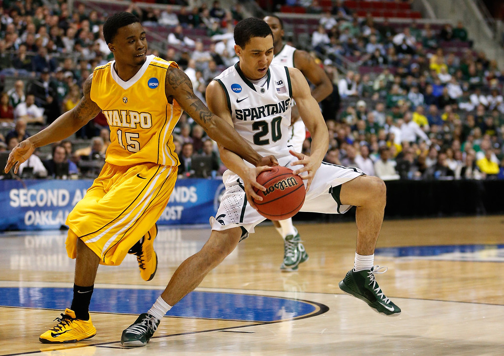 . Travis Trice #20 of the Michigan State Spartans attempts to control the ball in the first half against Erik Buggs #15 of the Valparaiso Crusaders during the second round of the 2013 NCAA Men\'s Basketball Tournament at at The Palace of Auburn Hills on March 21, 2013 in Auburn Hills, Michigan.  (Photo by Gregory Shamus/Getty Images)