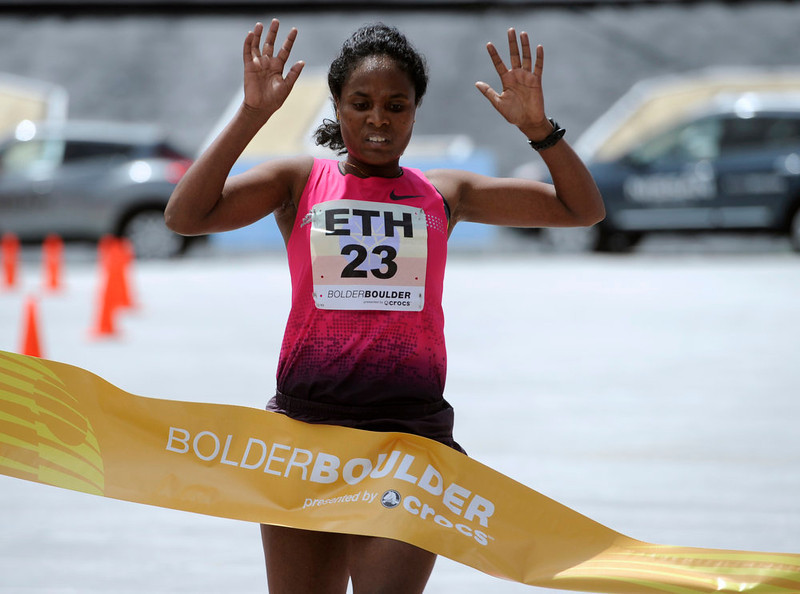 . The 35th BolderBoulder 10k classic takes place on the streets of Boulder finishing at Folsom Field at the University of Colorado. (Photo By Kathryn Scott Osler/The Denver Post)