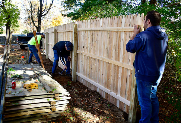 10/26/2019 Mike Orazzi | StaffrVolunteers from Loureiro Engineering, Adam Pogorzelski, Greg Longo and Ryan Kelting while working on the CCARC group home property in Plainville on Saturday.